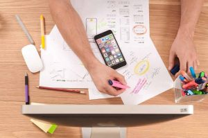 Beihilfe Service Arbeit Planung Hände Stifte Smartphone Beratung